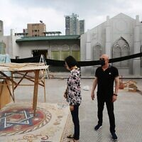 NaTang, left, and Jeffrey D. Schwartz inspect the rooftop plaza in Taiwan's new Jewish community center, currently under construction. (Glenn Leibowitz)