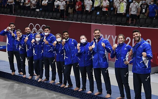 Members of Israel's team pose with their bronze medals after the medal ceremony in team judo competition at the 2020 Summer Olympics, on July 31, 2021, in Tokyo, Japan. (Israel Olympic Association)