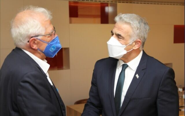 Foreign Minister Yair Lapid (right) and the European Union's top diplomat, Josep Borrell, in Brussels on July 11, 2021. (Twitter)