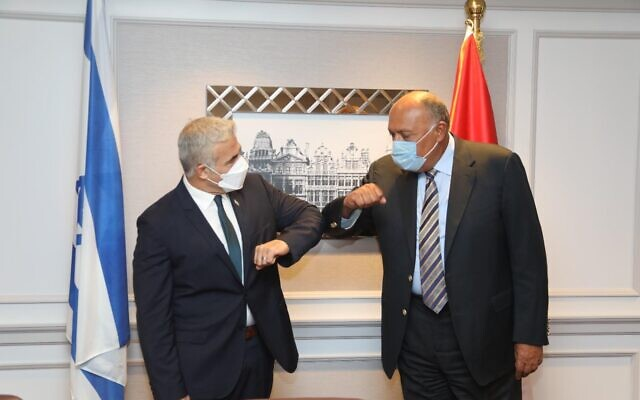Foreign Minister Yair Lapid meets his Egyptian counterpart Sameh Shoukry in Brussels, July 11, 2021. (Gabi Farkash, GPO)