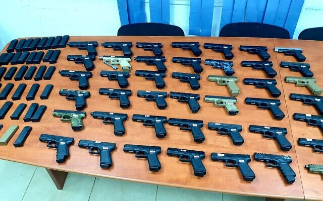 Dozens of guns seized during a smuggling operation from Lebanon, on July 10, 2021. (Israel Defense Forces)