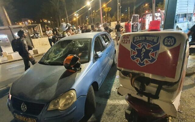 A car belonging to an Israeli family that was hit by rocks thrown by Palestinians near Damascus Gate, in Jerusalem, July 18, 2021. (United Hatzalah)