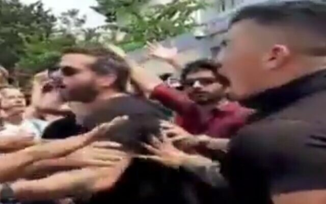 Protesters arguing with police outside the home of Naftali Bennett in Ra'anana on July 23, 2021. (screen capture: Twitter)