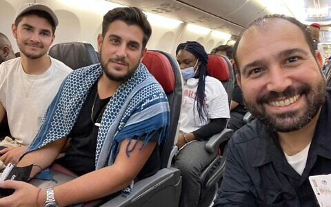 Three Israeli filmmakers held in Nigeria for 20 days pictured after their release, on their flight from Abuja to Istanbul before boarding a plane for Israel, July 28, 2021 (courtesy)