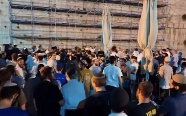 Far-right Orthodox Jews disrupted prayers being conducted by the Conservative Movement at the pluralistic prayer plaza at the Western Wall, on July 17, 2021. (Screenshot/Twitter)