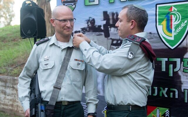 Colonel Sharon Asman, left, upon his appointment to commander of the Nahal Brigade on June 28, 2021, three days before his sudden death. (IDF)
