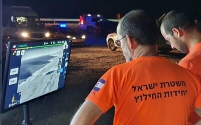 Police search and rescue teams use a drone with a thermal camera to try and find two people who were swept out to sea in the Dead Sea on July 23, 2021 (Israel Police)