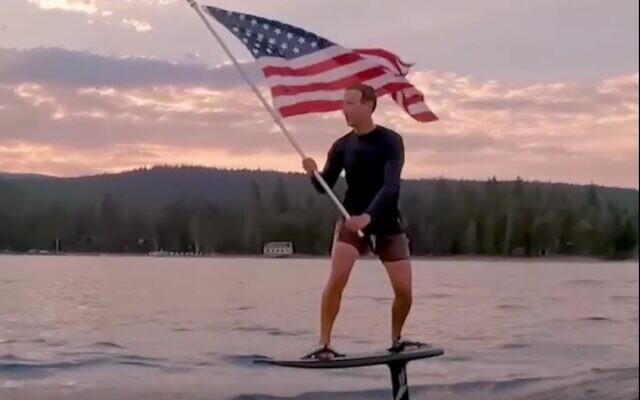 Facebook CEO Mark Zuckerberg surfs on an electric hydroboard while waving an American flag in a July 4 video (Screenshot)