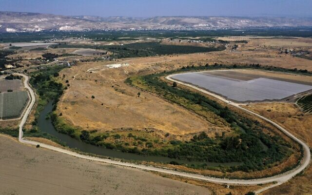An aerial picture taken on July 15, 2021, shows a section of the Jordan River flowing along the border with Jordan (background), south of the Sea of Galilee, or Lake Tiberias, one of the main water sources in Israel. (MENAHEM KAHANA / AFP)