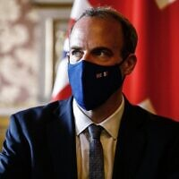 Britain's Foreign Secretary Dominic Raab looks on before signing an agreement with his French counterpart (not seen) in Paris on July 26, 2021. (Sameer Al-Doumy/AFP)