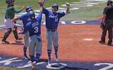 Israel's Daniel Valencia (2nd R, #19) celebrates his three run home run with teammates during the third inning of the Tokyo 2020 Olympic Games baseball round 1 game between Israel and Mexico at Yokohama Baseball Stadium in Yokohama, Japan, on August 1, 2021. (KAZUHIRO FUJIHARA / AFP)