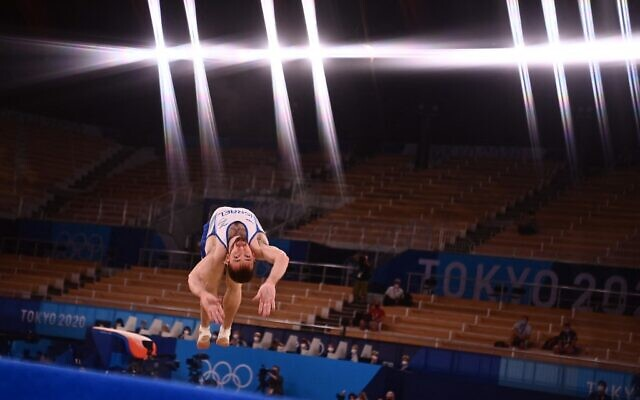 Israel's Artem Dolgopyat competes in the floor event of the artistic gymnastics men's floor exercise final during the Tokyo 2020 Olympic Games at the Ariake Gymnastics Centre in Tokyo on August 1, 2021. (Loic VENANCE / AFP)