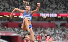 Israel's Hanna Knyazyeva-Minenko competes in the women's triple jump final during the Tokyo 2020 Olympic Games at the Olympic Stadium in Tokyo on August 1, 2021. (Andrej Isakovic/AFP)