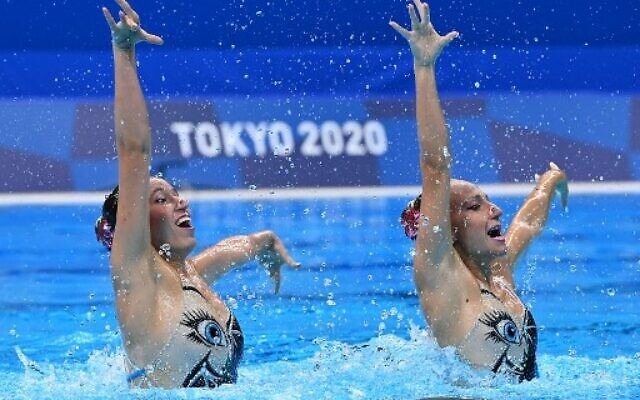 Israel's Eden Blecher and Israel's Shelly Bobritsky compete in the preliminary for the women's duet free artistic swimming event during the Tokyo 2020 Olympic Games at the Tokyo Aquatics Centre in Tokyo on August 2, 2021. (Photo by Attila KISBENEDEK / AFP)