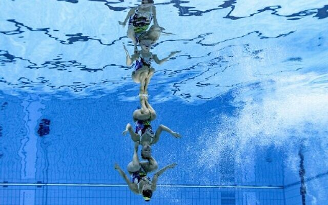 An underwater view shows Israel's Eden Blecher and Shelly Bobritsky compete in the preliminary for the women's duet free artistic swimming event during the Tokyo 2020 Olympic Games at the Tokyo Aquatics Centre in Tokyo on August 2, 2021. (François-Xavier MARIT / AFP)