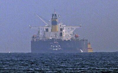 Tugboats are moored next to the Israeli-linked tanker MT Mercer Street, off the Fujairah port in the United Arab Emirates, on August 3, 2021. (Karim Sahib/AFP)