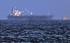 Tug boats are moored next to the Israeli-managed tanker MT Mercer Street, off the Fujayrah port in the United Arab Emirates, on August 3, 2021. (Karim Sahib/AFP)