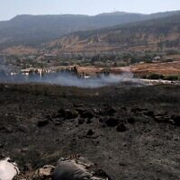 Burnt fields near the northern town of Kiryat Shmona following rocket fire from Lebanon, on August 4, 2021. (JALAA MAREY / AFP)