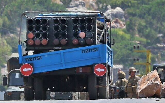 Lebanese soldiers stand next to a truck carrying a multiple rocket launcher after confiscating it, in the southern village of Shouayya, on August 6, 2021 (Mahmoud ZAYYAT / AFP)