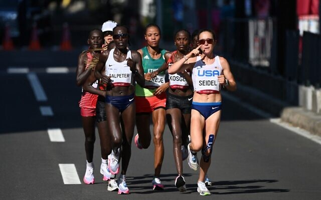(From L) Israel's Lonah Chemtai Salpeter, Kenya's Brigid Kosgei qnd USA's Molly Seidel compete in the women's marathon final during the Tokyo 2020 Olympic Games in Sapporo on August 7, 2021. (Charly TRIBALLEAU / AFP)