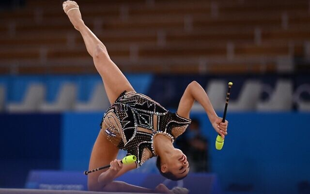 Israel's Linoy Ashram competes in the individual all-around final of the Rhythmic Gymnastics event during Tokyo 2020 Olympic Games at Ariake Gymnastics centre in Tokyo, on August 7, 2021. (Martin BUREAU / AFP)
