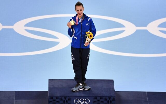 Israel's Linoy Ashram poses with her gold medal during the podium ceremony of the individual all-around final of the Rhythmic Gymnastics event during Tokyo 2020 Olympic Games at Ariake Gymnastics centre in Tokyo, on August 7, 2021. (Martin Bureau/AFP)