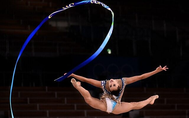 Israel's Linoy Ashram competes in the individual all-around final of the Rhythmic Gymnastics event during Tokyo 2020 Olympic Games at Ariake Gymnastics centre in Tokyo, on August 7, 2021. (Lionel Bonaventure/AFP)