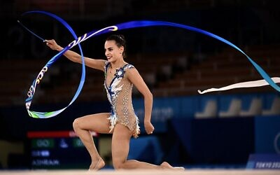Israeli gold medalist Linoy Ashram competes in the individual all-around final of the Rhythmic Gymnastics event during Tokyo 2020 Olympic Games, on August 7, 2021. (Lionel Bonaventure/AFP)