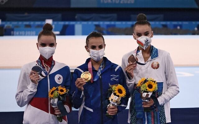 Russia's Dina Averina (silver), Israel's Linoy Ashram (gold) and Belarus' Alina Harnasko (bronze) pose during the medal ceremony of the individual all-around final of the Rhythmic Gymnastics event during Tokyo 2020 Olympic Games at Ariake Gymnastics center in Tokyo, on August 7, 2021. (Lionel Bonaventure/AFP)