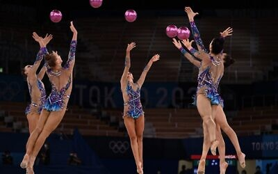 Team Israel competes in the group all-around final of the Rhythmic Gymnastics event during Tokyo 2020 Olympic Games at Ariake Gymnastics centre in Tokyo, on August 8, 2021. (Lionel BONAVENTURE / AFP)