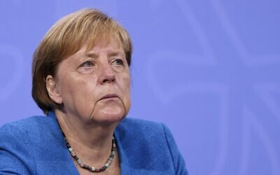 German Chancellor Angela Merkel looks on during a press conference at the Chancellery in Berlin, on August 10, 2021. (Christian Mang/Pool/AFP)