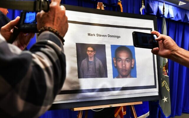 In this file photo taken on April 29, 2019, photographers capture images of suspect Mark Steven Domingo, arrested in connection with an alleged terror plot targeting Southern California sites, in Los Angeles. (Frederic J. BROWN / AFP)
