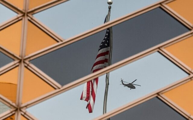 The US flag is reflected on the windows of the US embassy building in Kabul, Afghanistan, July 30, 2021. (Sajjad Hussain/AFP)