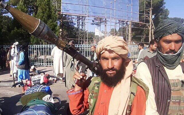 In this picture taken on August 13, 2021, a Taliban fighter holds a rocket-propelled grenade (RPG) along the roadside in Herat, Afghanistan's third biggest city, after government forces pulled out the day before following weeks of being under siege. (AFP)