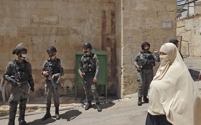 Border Police troops are seen deployed as Palestinian worshippers protest following Friday prayers at the Tomb of the Patriarchs denouncing Israeli construction plans at the site, in the city of Hebron in the West Bank on August 13, 2021. (HAZEM BADER / AFP)