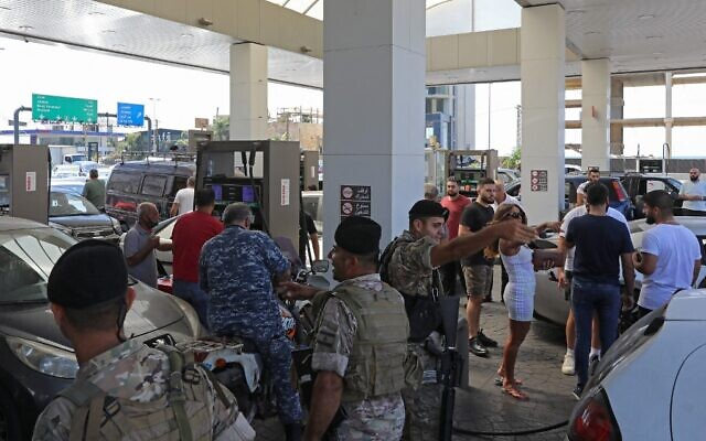 Lebanese soldiers are seen at a gas station in the capital Beirut, on August 14, 2021, after soldiers were deployed to force several stations to reopen their doors. (Anwar Amro/AFP)