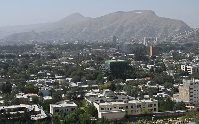 This picture taken from the top of a hillside shows a general view of the Kabul city on August 15, 2021. (Wakil KOHSAR / AFP)