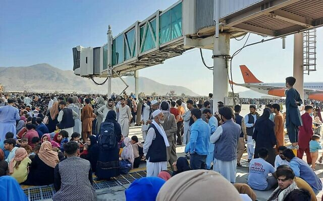 Afghans crowd at the tarmac of the Kabul airport on August 16, 2021, to flee the country as the Taliban were in control of Afghanistan after President Ashraf Ghani fled the country and conceded the insurgents had won the 20-year war. (AFP)