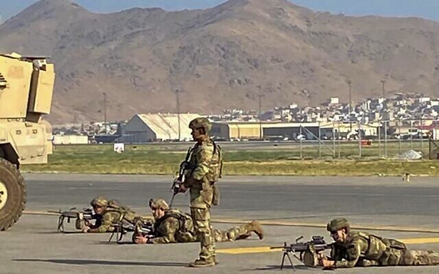 US soldiers take up positions as they secure the airport in Kabul on August 16, 2021. (Shakib Rahmani/AFP)