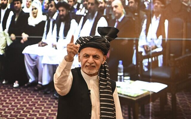 Afghanistan's President Ashraf Ghani gestures during a function at the Afghan presidential palace in Kabul, August 4, 2021. (Sajjad Hussain/AFP)