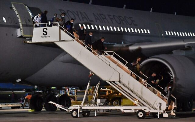 Passengers repatriated from Afghanistan, disembark from an RAF Airbus KC2 Voyager aircraft, after landing at RAF Brize Norton, southern England, on August 17, 2021.(Mark Large / POOL / AFP)