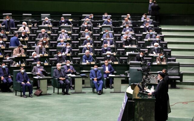 Iran's President Ebrahim Raisi speaks before parliament to defend his cabinet selection in the capital Tehran, on August 21, 2021. (Atta Kenare/AFP)