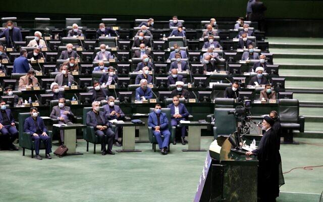 Iranian President Ebrahim Raisi speaks before parliament in the capital Tehran on August 21, 2021. (Atta Kenare/AFP)