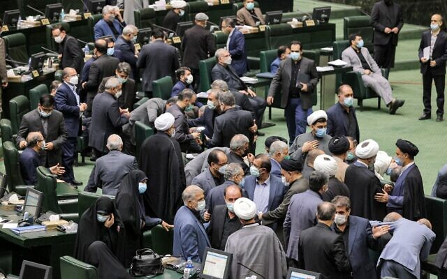 Iranian lawmakers attend a parliament session to review the new president's cabinet selection in the capital Tehran on August 21, 2021. (ATTA KENARE / AFP)