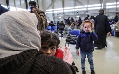 Afghan evacuees are pictured at the US Air Base Ramstein, Germany on August 26, 2021 (Armando BABANI / AFP)
