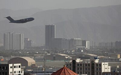 A US Air Force aircraft takes off from the military airport in Kabul on August 27, 2021, as the Pentagon said the evacuation of tens of thousands of people from Afghanistan still faces more possible attacks like the bombing that killed scores of people outside the Kabul airport. (AFP)