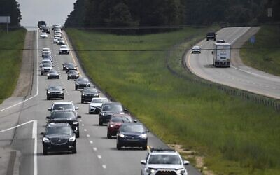 US residents drive north (L) on Interstate Highway 55 near Magnolia, Mississippi, as they evacuate away from New Orleans on August 28, 2021, before the arrival of Hurricane Ida. (Photo by Patrick T. FALLON / AFP)