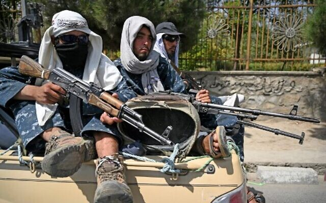 Taliban fighters patrol a street in Kabul on August 29, 2021, as suicide bomb threats hung over the final phase of the US military's airlift operation from Kabul, with President Joe Biden warning another attack was highly likely before the evacuations end. (Photo by Aamir QURESHI / AFP)