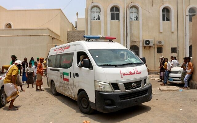 An ambulance transports casualties of strikes on Al-Anad air base to the Ibn Khaldun hospital in the government-held southern province of Lahij, in Yemen, August 29, 2021. (Saleh OBAIDI / AFP)