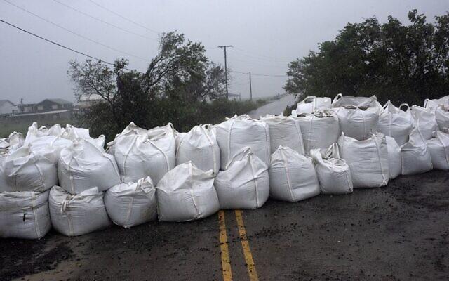 Rain comes down at a wall of sandbags in Montegut, Louisiana, before Hurricane Ida lands on August 29, 2021. (Mark Felix/AFP)